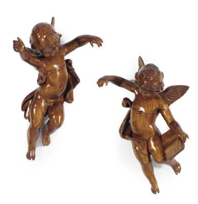 A PAIR OF MAHOGANY FIGURES OF