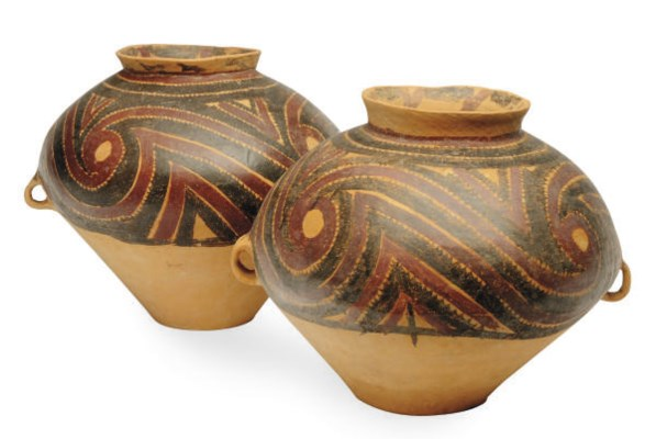 TWO CHINESE PAINTED RED POTTER