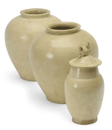 A PAIR OF CHINESE CREAM-GLAZED