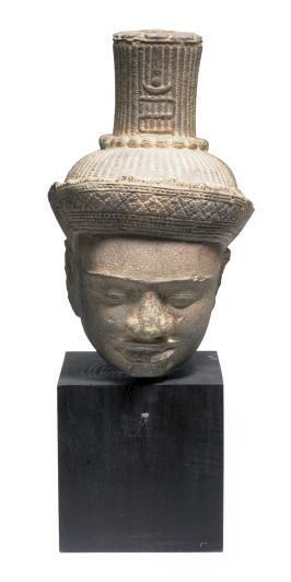 A KHMER STONE HEAD OF A BUDDHA
