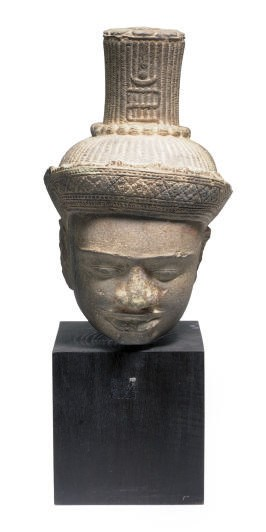 A KHMER STONE HEAD OF A BUDDHA