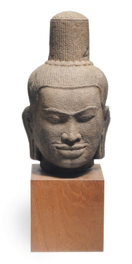 A KHMER SANDSTONE HEAD OF SHIV