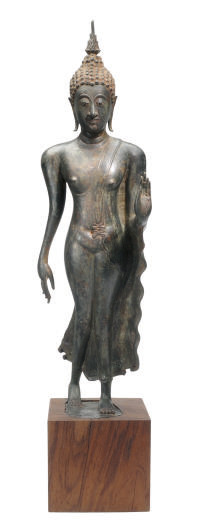 A THAI STRIDING BRONZE FIGURE