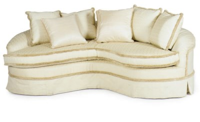 AN UPHOLSTERED DEMILUNE SOFA,