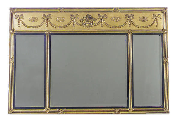 A GILTWOOD AND EBONIZED MIRROR