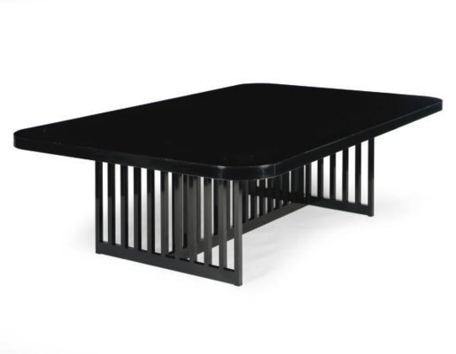 A BLACK LACQUERED DINING TABLE