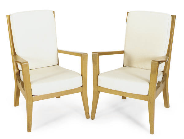 A PAIR OF FRENCH OAK ARMCHAIRS