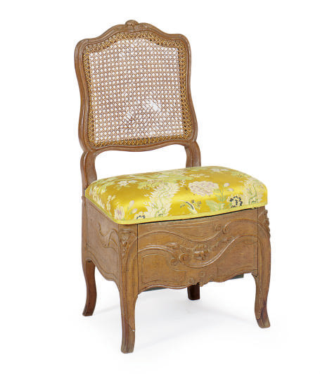 A LOUIS XV WALNUT AND CANED BI