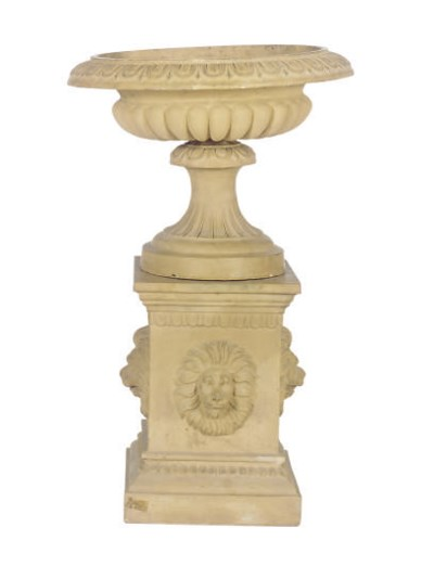 AN EARTHENWARE GARDEN URN ON P