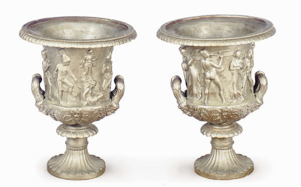 A PAIR OF SILVER-PAINTED CAST-