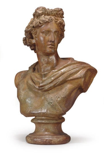 A PAINTED TERRACOTTA BUST OF A