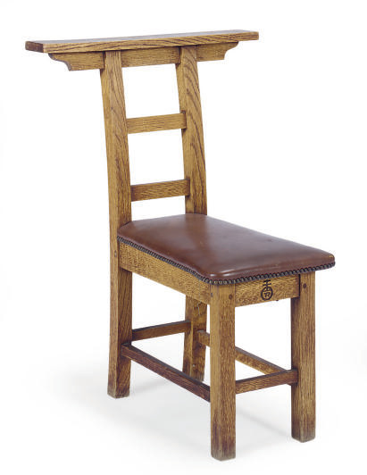 AN OAK AND LEATHER STRADDLE CH
