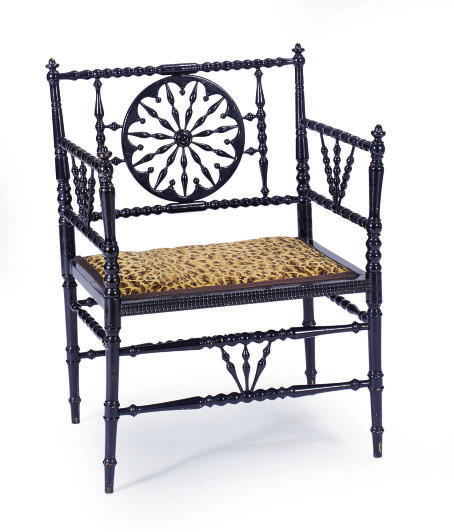 A VICTORIAN EBONIZED ARMCHAIR,