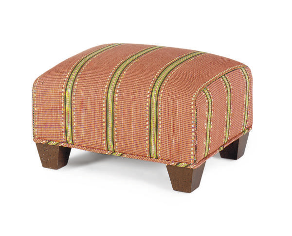 A STAINED WOOD AND UPHOLSTERED