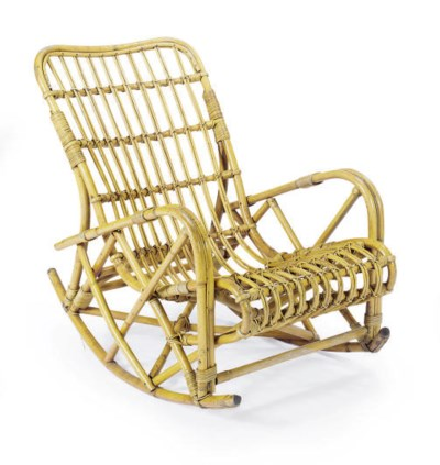 A RATTAN ROCKING CHAIR,