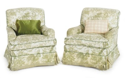 A PAIR OF UPHOLSTERED LOUNGE C