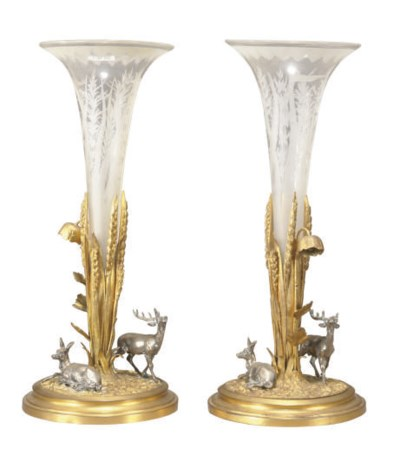 A PAIR OF SILVERED AND GILT-BR