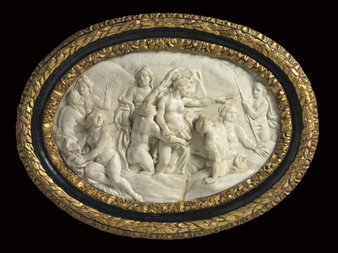 A GERMAN CARVED WHITE MARBLE R