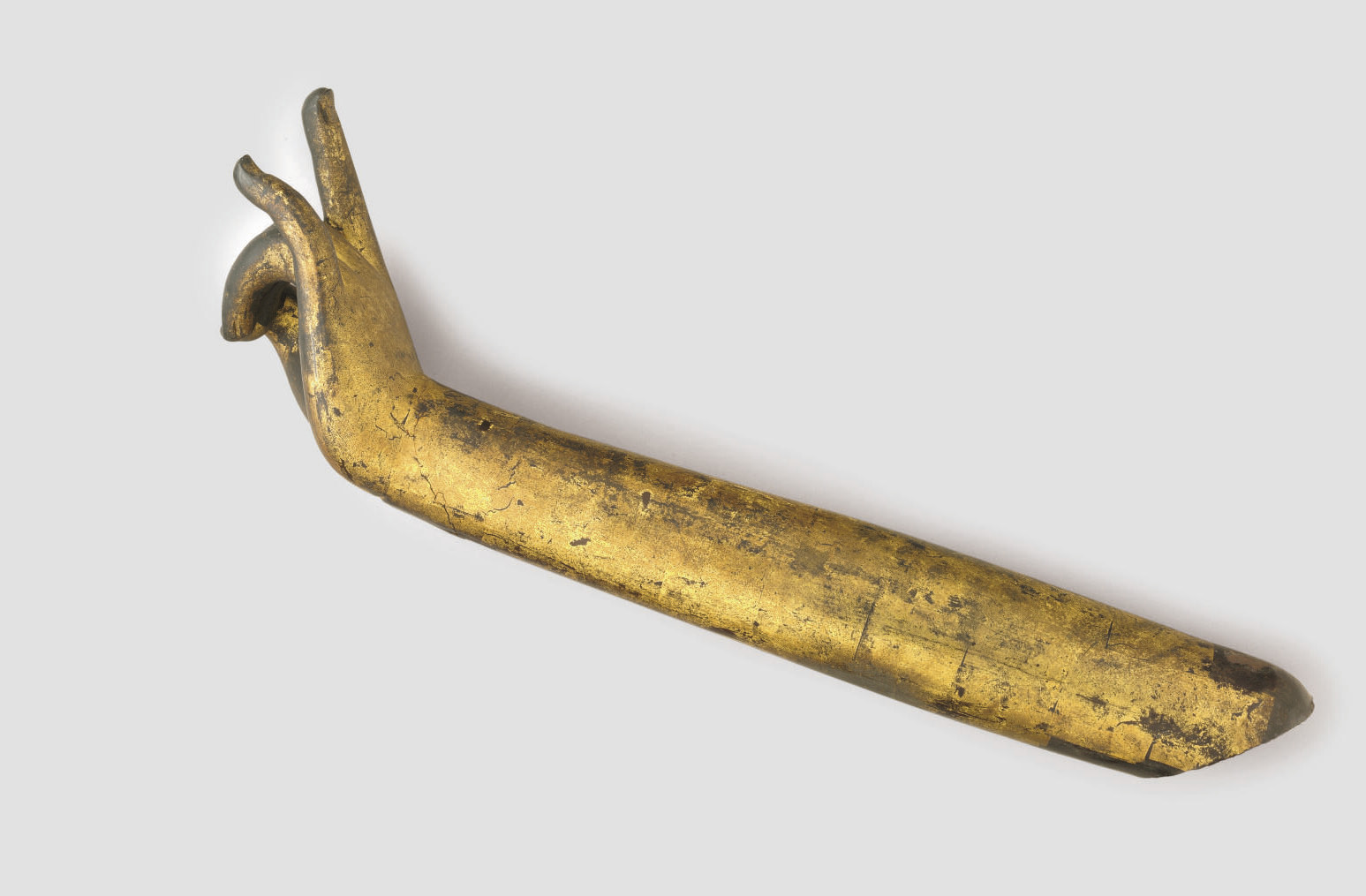 A gilt and lacquered wood arm