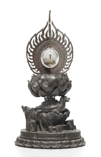 A bronze and crystal reliquary