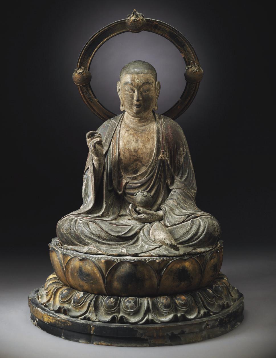 A seated figure of Jizo Bosats