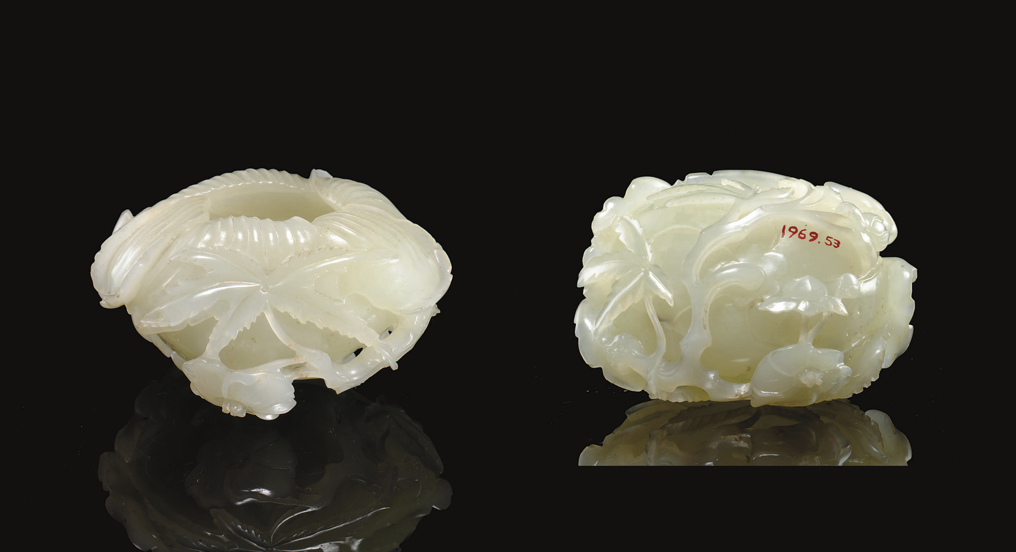 A FINELY CARVED WHITE JADE HIB