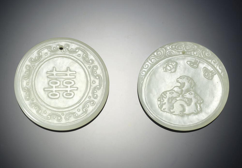TWO WHITE JADE CIRCULAR PENDAN