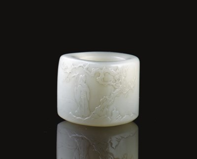 A FINELY CARVED PALE GREENISH-