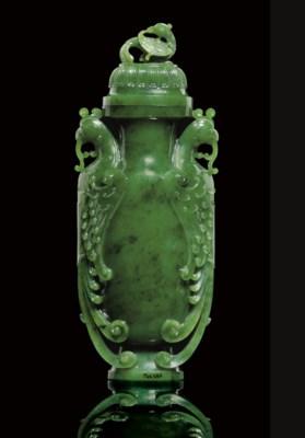 A BRILLIANT GREEN JADE VASE AN