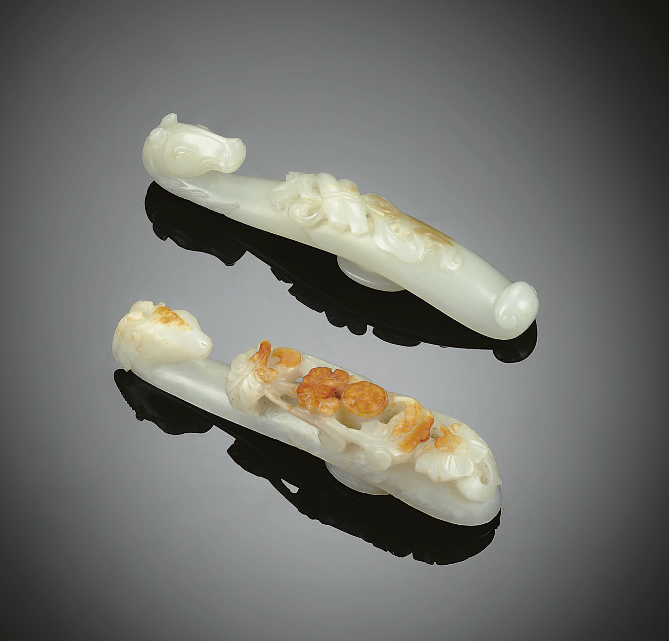 TWO FINELY CARVED WHITE JADE B