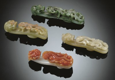 A GROUP OF FOUR JADE AND JADEI