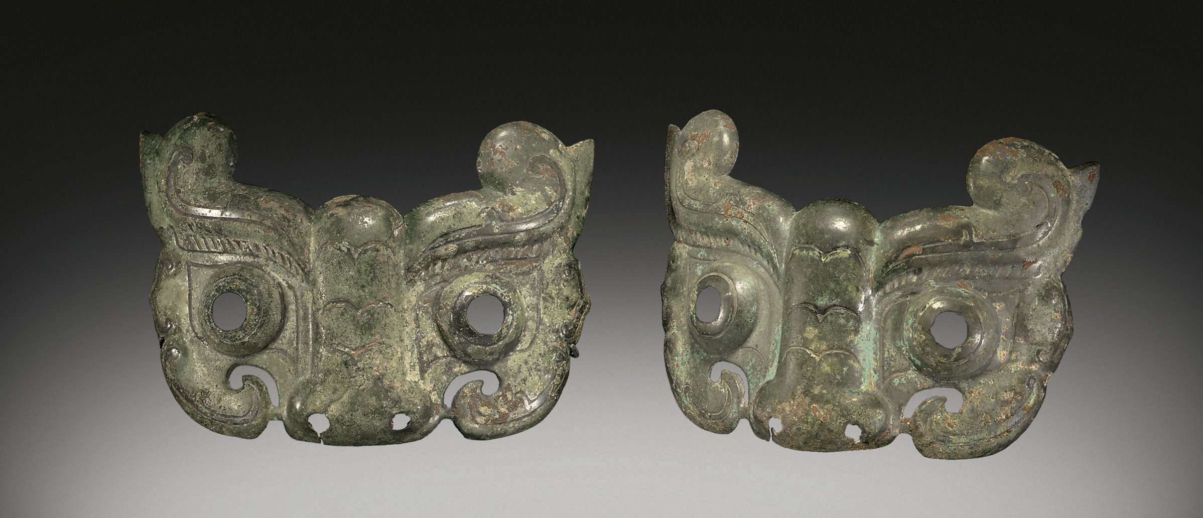 A RARE PAIR OF BRONZE MASK-FOR