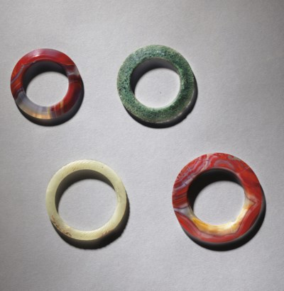 THREE AGATE RINGS AND A WHITE