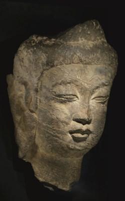 A BLACK STONE HEAD OF BUDDHA
