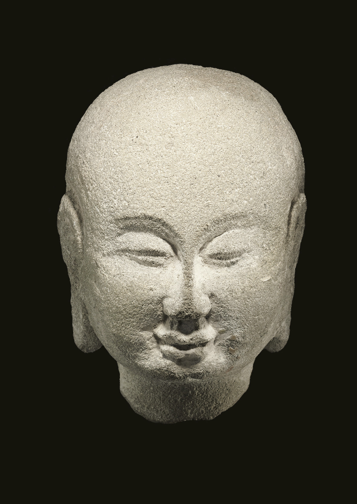 A SANDSTONE HEAD OF A MONK