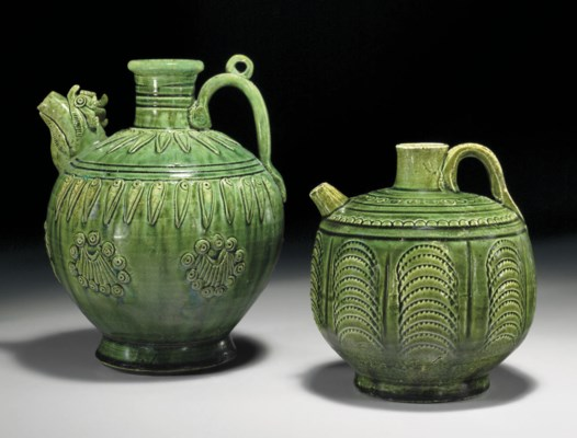 TWO GREEN-GLAZED POTTERY EWERS