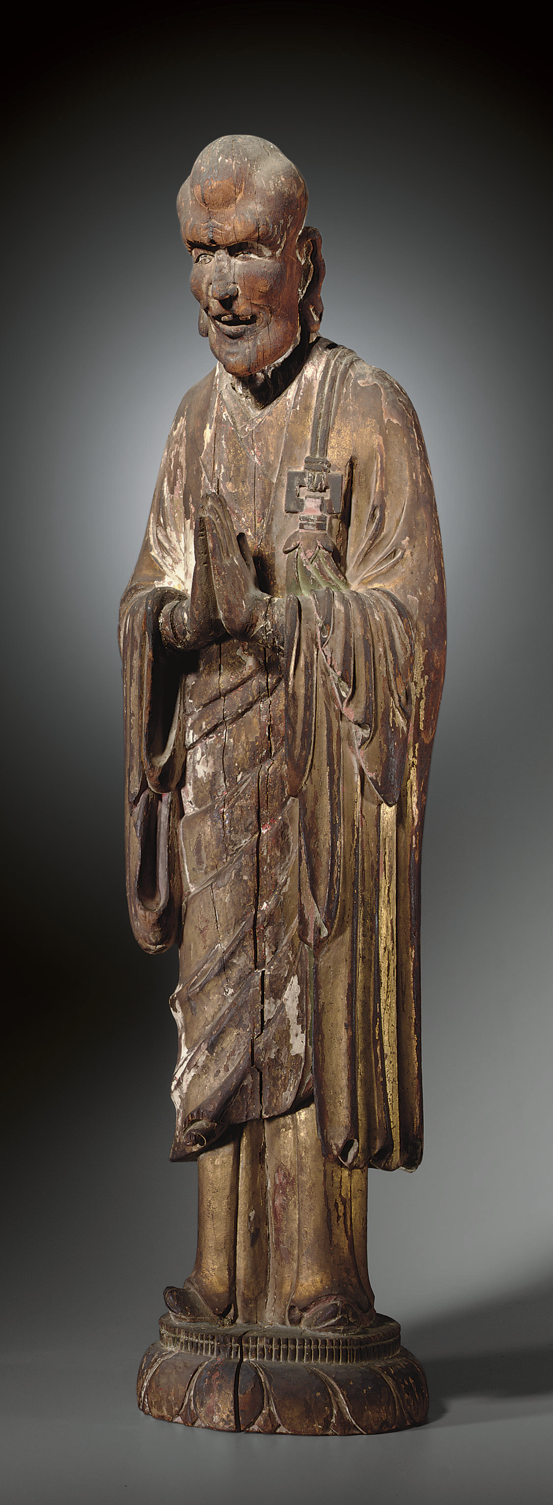 AN UNUSUAL CARVED WOOD FIGURE