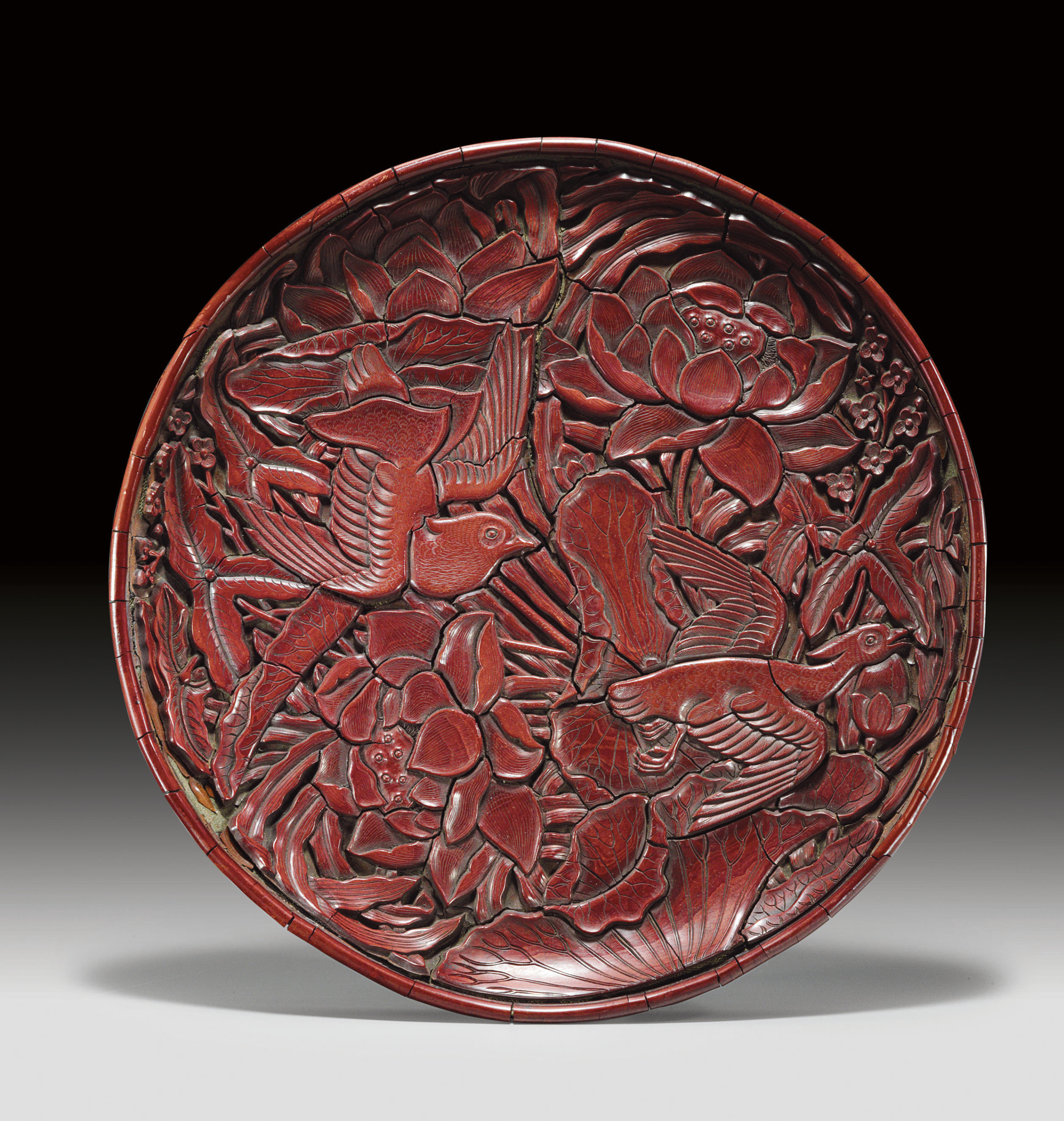A VERY RARE CARVED RED LACQUER