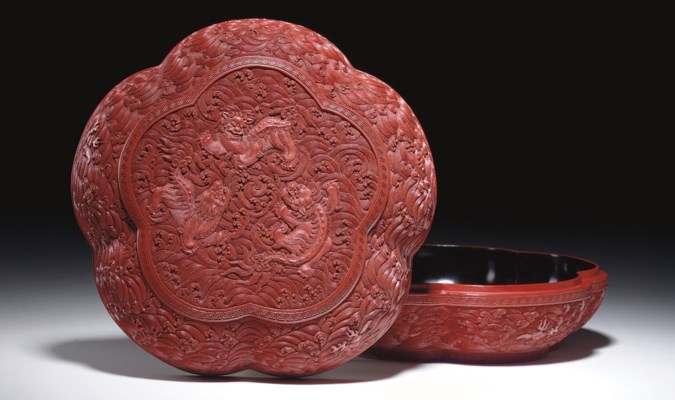 A CARVED RED LACQUER CINQUELOB
