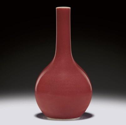 A COPPER-RED-GLAZED BOTTLE VAS