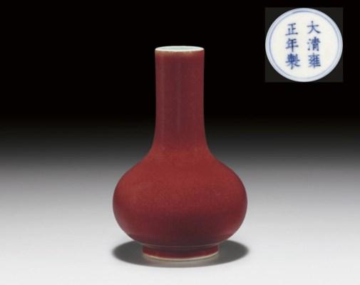 A SMALL COPPER-RED-GLAZED BOTT