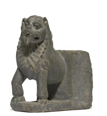 A gray schist figure of a lion