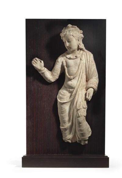 A rare stucco figure of a bodh