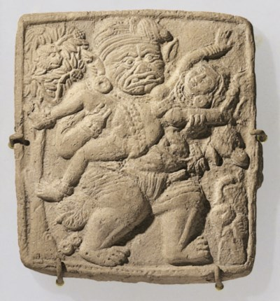 A terracotta plaque with scene