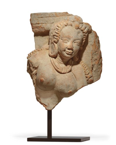 A terracotta bust of a devi