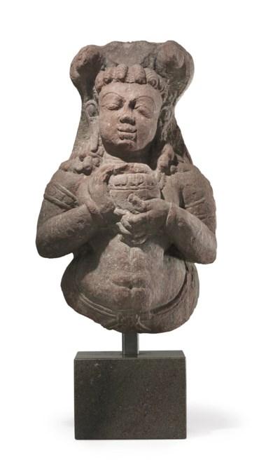 A mottled red sandstone figure