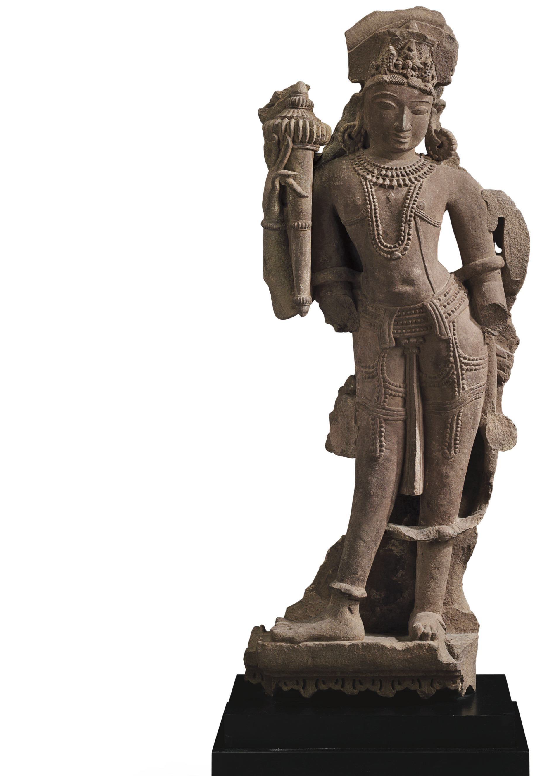 A red sandstone figure of a st