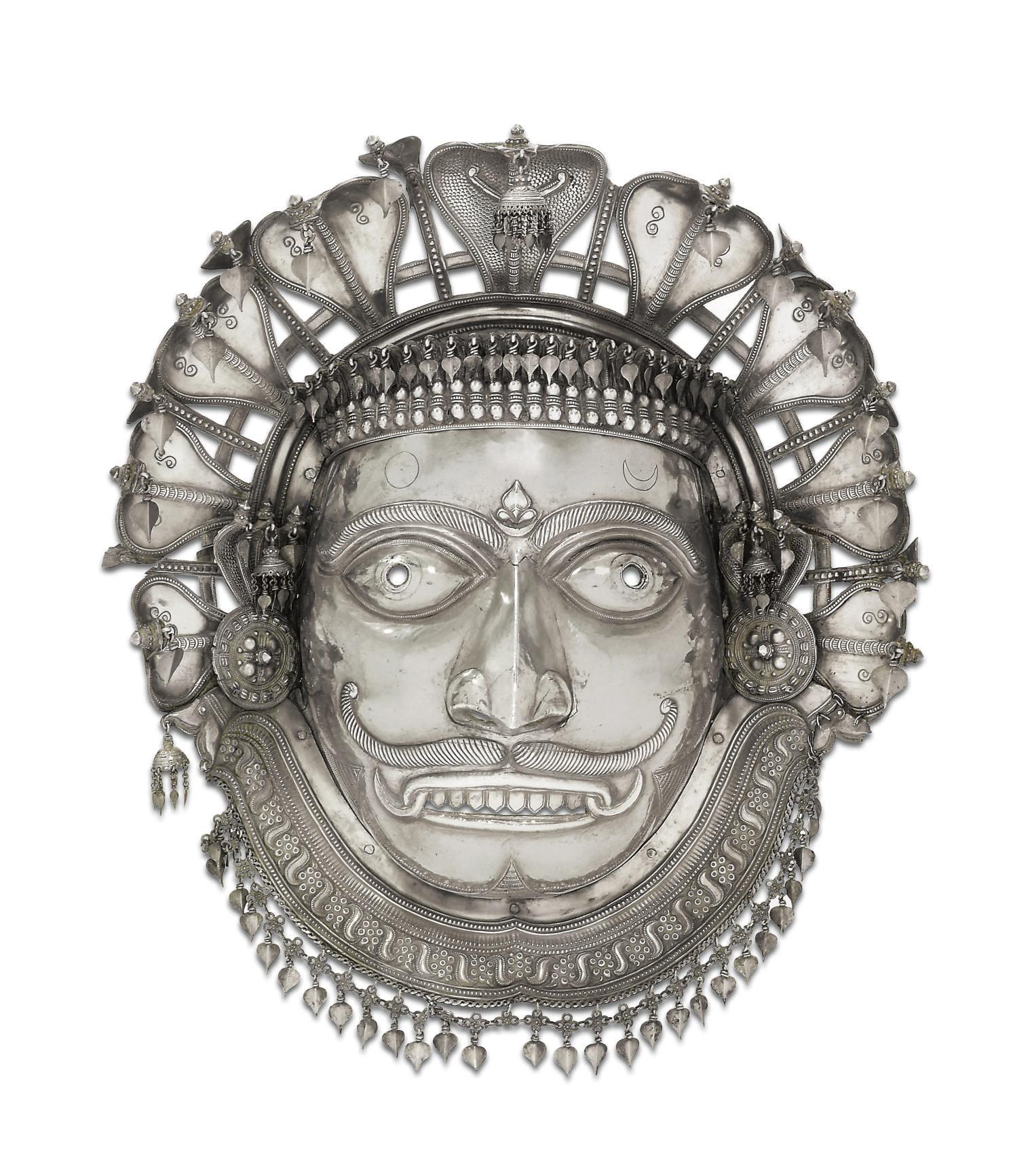 A rare silver mask of Shiva