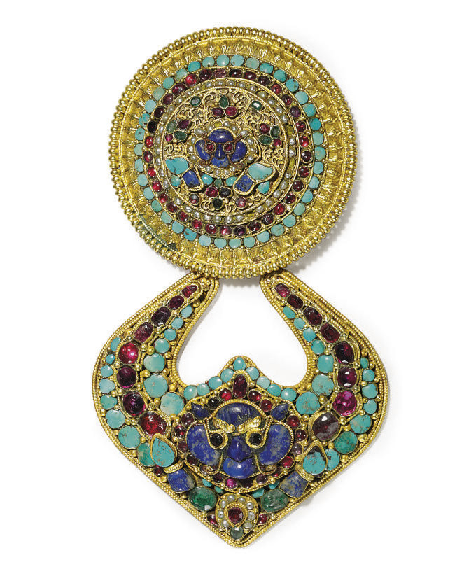 A silver gilt pendant with inl