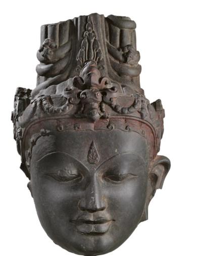 A black stone head of Vishnu